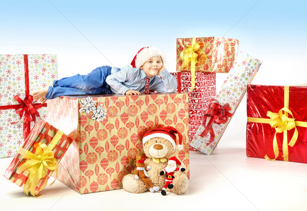 Little cute boy with plenty of gifts Stock photo © konradbak