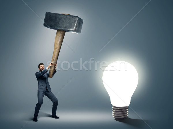 Conceptual image of a businessman holding huge hammer Stock photo © konradbak