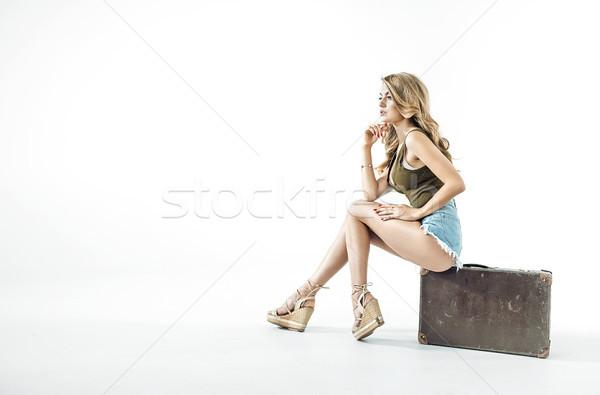 довольно блондинка сидят Камера изолированный Сток-фото © konradbak