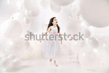 Bonitinho mulher jovem numeroso balões branco moda Foto stock © konradbak