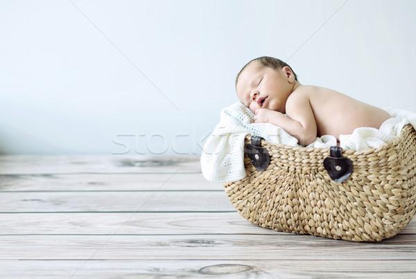Bonitinho criança adormecido cesta Foto stock © konradbak