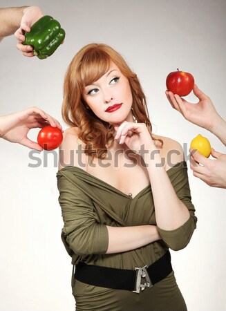 Beautiful woman making a fruit choice Stock photo © konradbak