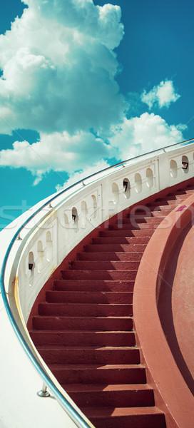 Stairs towards blue sky with clouds Stock photo © konradbak