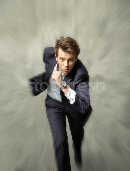 Young businessman achieving the succes Stock photo © konradbak