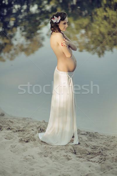 Pregnant nymph realxing by the lakeside Stock photo © konradbak