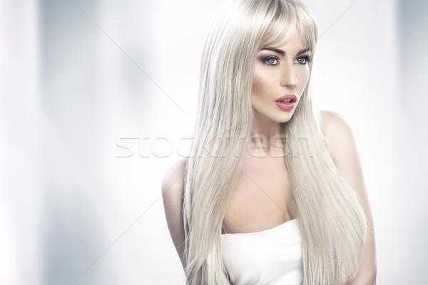 Alluring young woman with long blond hair Stock photo © konradbak