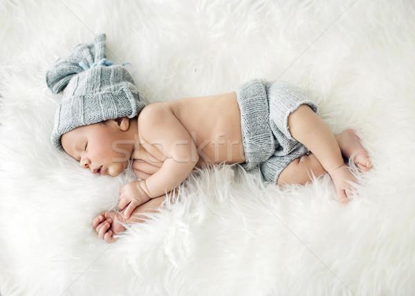 Newborn child sleeping on the blanket Stock photo © konradbak