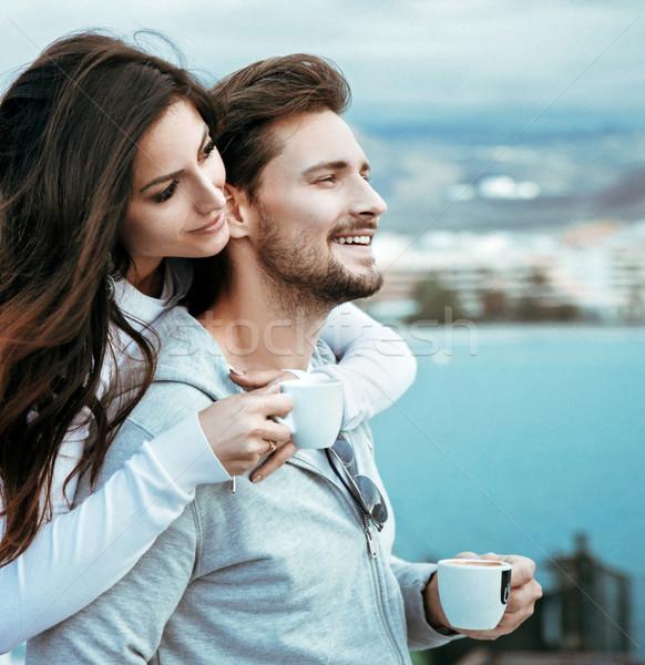 Portrait of a relaxed couple drinking hot coffee Stock photo © konradbak