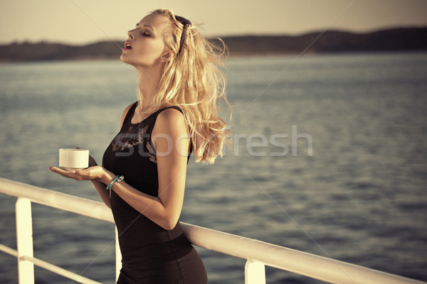 Sensual blonde girl with sunglasses Stock photo © konradbak