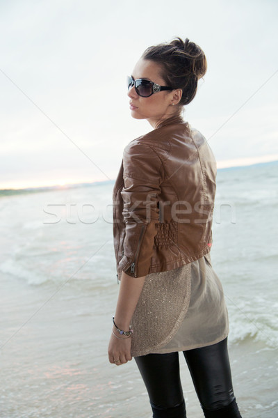 Pretty lady spending autumn by the sea Stock photo © konradbak