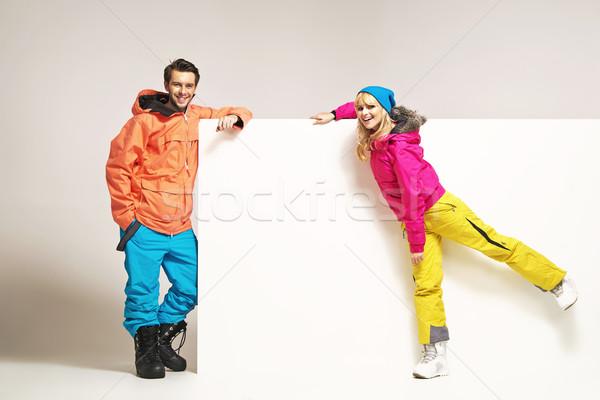 Attractive couple wearing colorful winter clothes Stock photo © konradbak