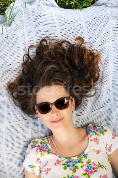 Alluring woman lying on the blanket Stock photo © konradbak