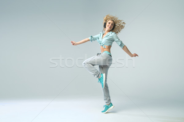 Shapely woman listeing to music Stock photo © konradbak