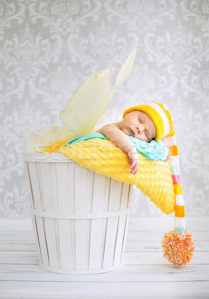 Little boy sleeping in the wicker basket Stock photo © konradbak