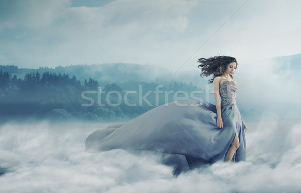 Magical brunette lady on a foggy field Stock photo © konradbak