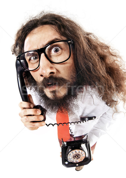 Funny portrait of a nerd talking on the phone Stock photo © konradbak