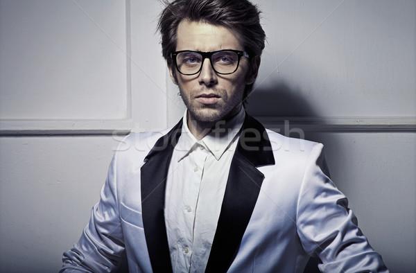 James Bond's style of young model Stock photo © konradbak