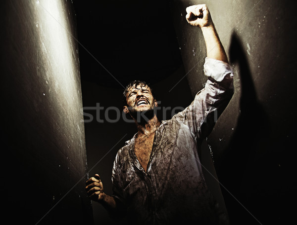 Exhausted victorious man after tough survival Stock photo © konradbak