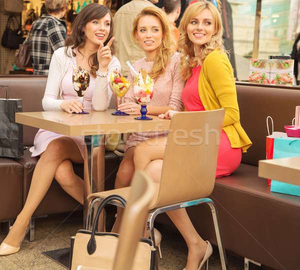 Stock photo: Relaxed women eating tasty ice cream