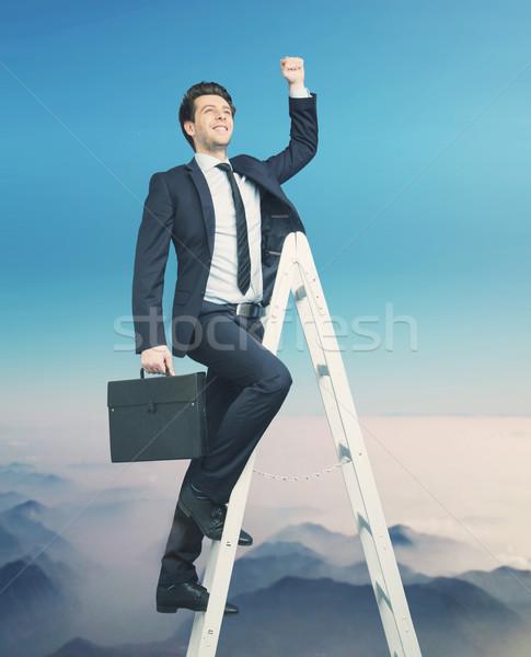 Ambitieus zakenman top business wolken licht Stockfoto © konradbak