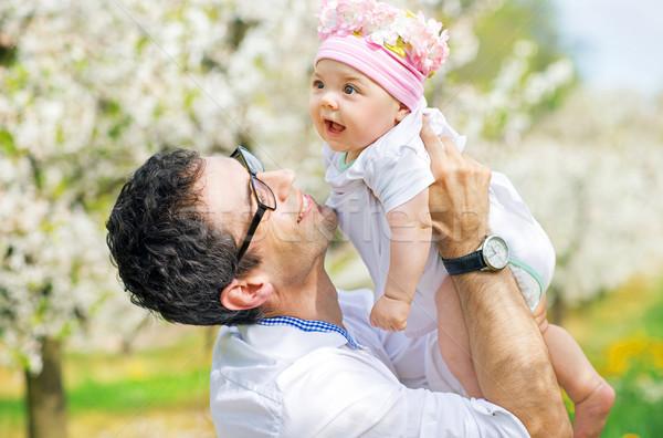 Happy father cuddling his cute daughter Stock photo © konradbak