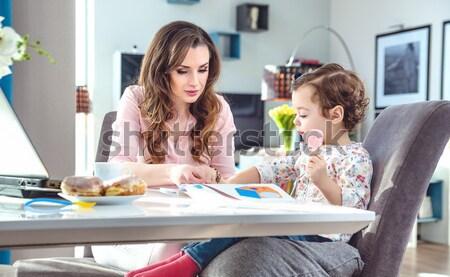Cheerful mother teaching her children how to bake a cake Stock photo © konradbak