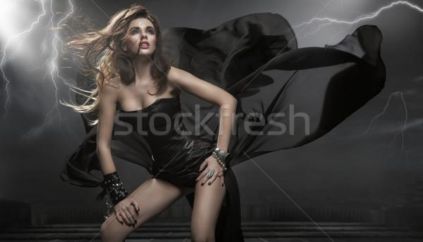 Káprázatos nő visel fekete ruha modell szépség Stock fotó © konradbak