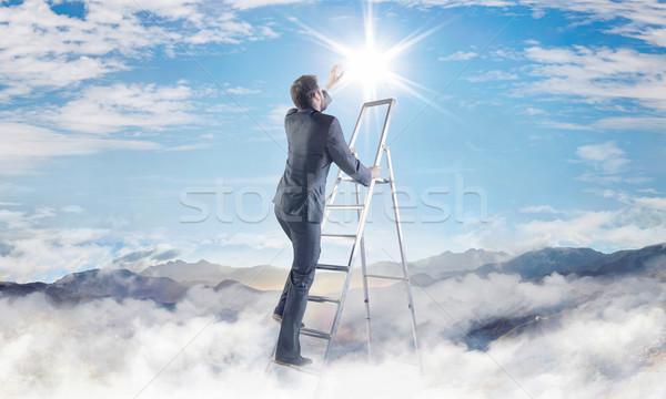 Conceptual picture of businessman achieving a success Stock photo © konradbak