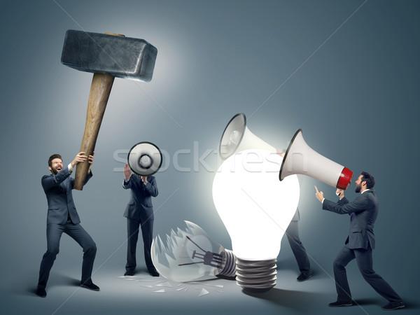 Conceptual image of smart businessmen with symbols Stock photo © konradbak
