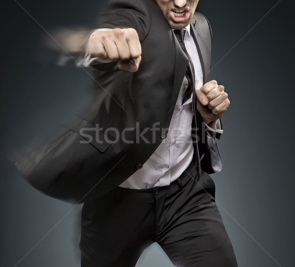 Handsome businessman dfeating a challanger Stock photo © konradbak
