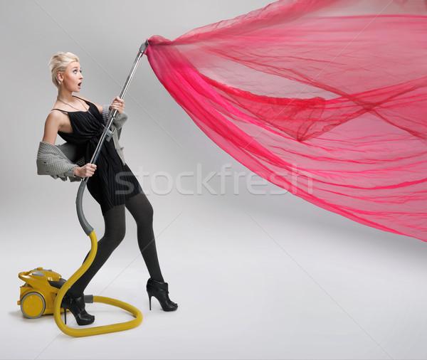 Młoda kobieta odkurzacz odizolowany kobieta pracy domu Zdjęcia stock © konradbak