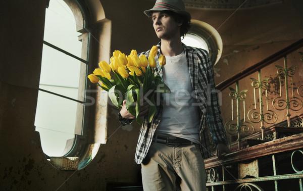 Romantic man holding bunch of tulips Stock photo © konradbak