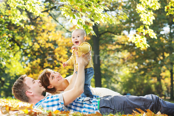 Stock photo: Caring parents looking after baby