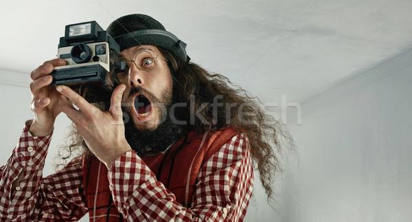 Flaco funny hombre toma tipo Foto stock © konradbak