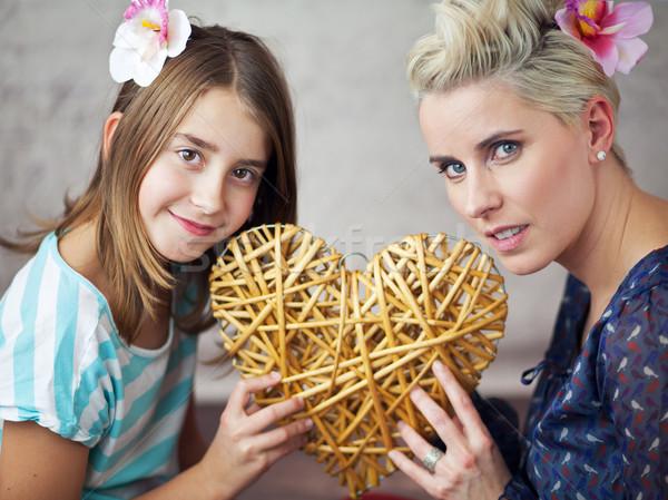 Mother and daughter keeping toy heart Stock photo © konradbak