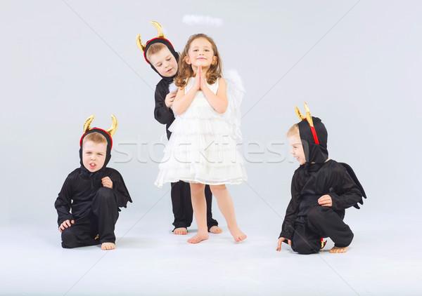 Little angel and three devils Stock photo © konradbak