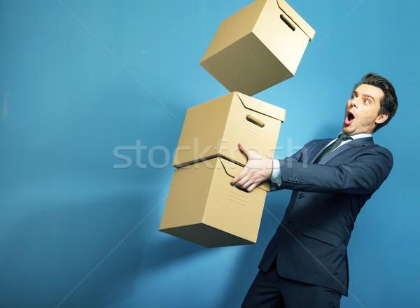 Meglepődött bankár dobozok papír férfi fény Stock fotó © konradbak
