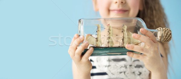 игрушку судно бутылку улыбка лет зубов Сток-фото © konradbak