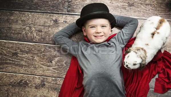 Portré kicsi illuzionista kéz háttér nyuszi Stock fotó © konradbak