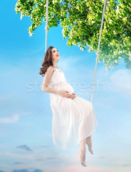 Terhes hölgy ül fából készült hinta hinta Stock fotó © konradbak