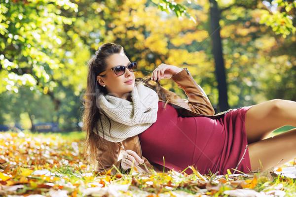 Elegant pregnant woman in the park Stock photo © konradbak