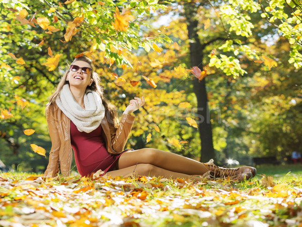 Smart lady watching autumn leaves Stock photo © konradbak