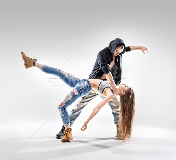 Acrobat pose of a two talented dancers Stock photo © konradbak