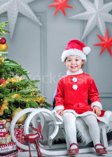 Aranyos kicsi manó ül szánkó karácsony Stock fotó © konradbak