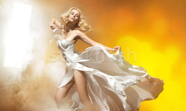 Sexy blond woman in amazing dress posing Stock photo © konradbak