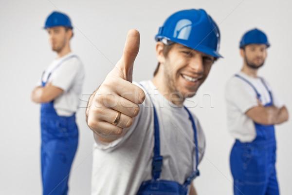Portrait trois optimiste travailleurs affaires travaux Photo stock © konradbak