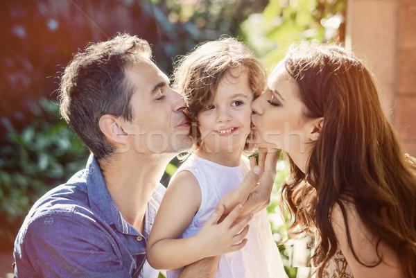 Felice genitori bacio amato bambino figlia Foto d'archivio © konradbak