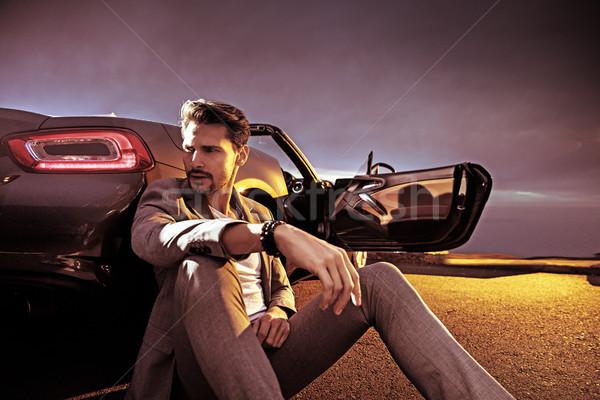 Handsome man sitting next to the car Stock photo © konradbak