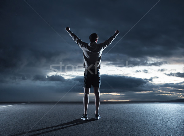 Genç jogging yapan izlerken karanlık gökyüzü bulutlar Stok fotoğraf © konradbak