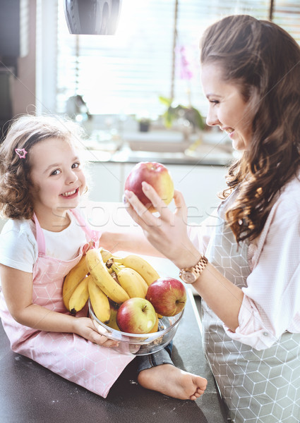 Cheerful family in a kitchen - fruit diet theme Stock photo © konradbak